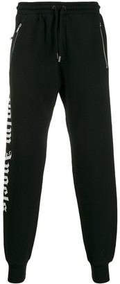 Palm Angels logo over jogging trousers