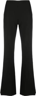 The Row long flared trousers