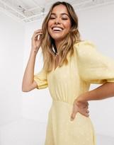 New Look frill hem mini dress in yellow polka dot