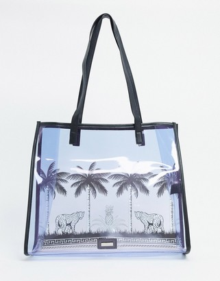 Skinnydip palm print tote bag in purple