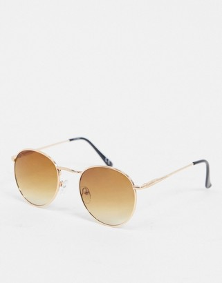 ASOS DESIGN round sunglasses in copper metal with brown grad lens