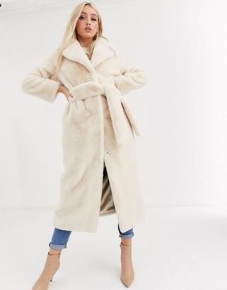 Asos Design DESIGN plush faux fur longline maxi with belt in cream