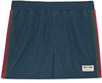 Gucci Waterproof nylon swim shorts with Web
