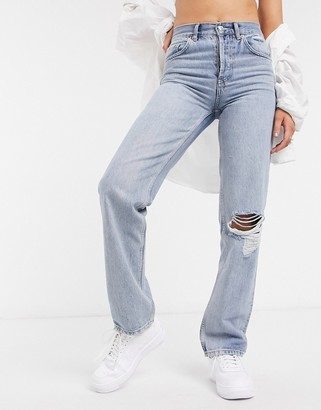 ASOS DESIGN mid rise '90's' straight leg jeans in midwash with rips