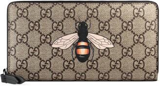 Gucci Bee print GG Supreme zip around wallet