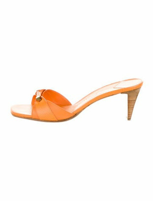 Louis Vuitton Embossed Leather Slides Orange