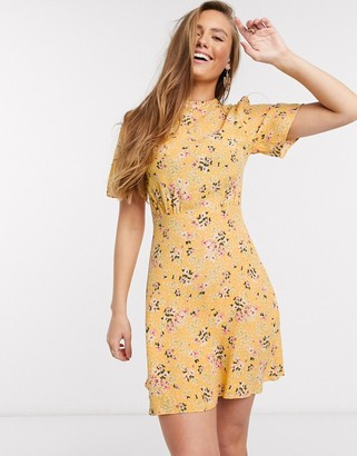 New Look flutter sleeve mini dress in yellow ditsy floral print