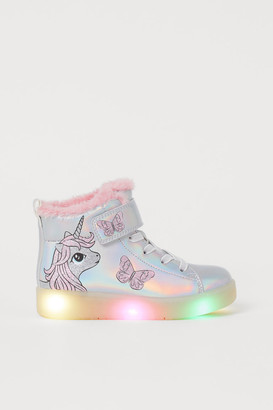 H&M Flashing hi-top trainers