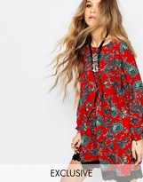 Reclaimed Vintage Long Sleeve Tunic Dress With Tie Back Detail In Red Floral