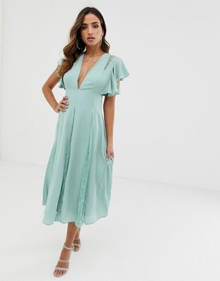 ASOS DESIGN midi dress with lace godet panels