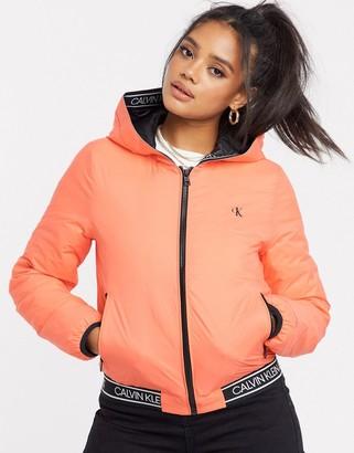 Calvin Klein Jeans reversible logo hooded padded jacket in pink