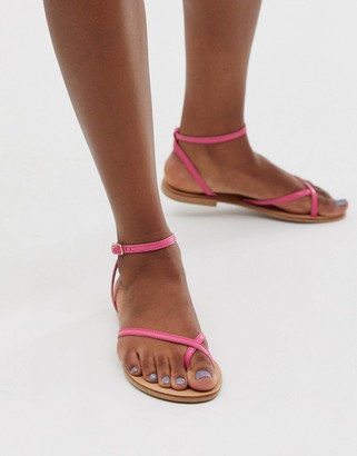 Asos Design DESIGN Freefall minimal toe loop flat sandals in pink