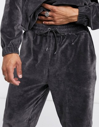 ASOS DESIGN co-ord oversized joggers in washed black velour