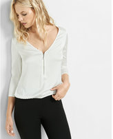 Express deep v-neck zip front banded bottom blouse