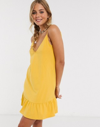 ASOS DESIGN v front mini sundress with pep hem in yellow