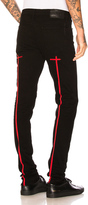 RtA for FWRD Cross Embroidery Skinny Jeans in Black.