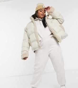 ASOS DESIGN Curve borg panelled puffer jacket in cream