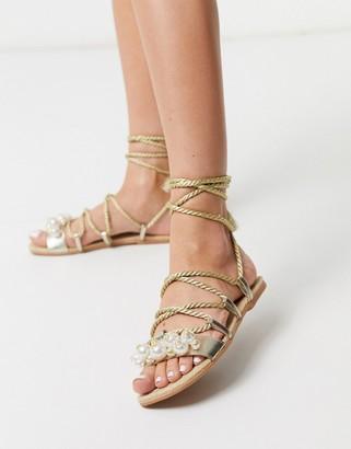ASOS DESIGN Jinessa embellished leather tie leg espadrille sandals in gold