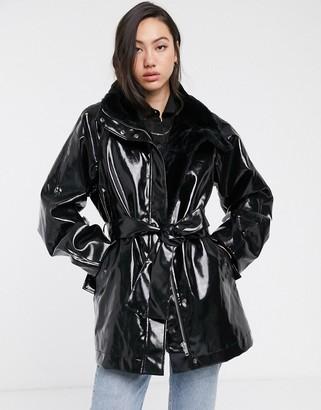 Weekday vinyl faux fur-lined belted coat in black