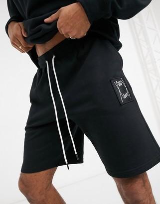 Puma Hoops shorts in black