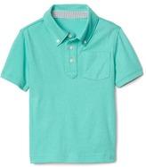 Button down pocket polo