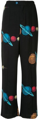 Undercover planet print trousers