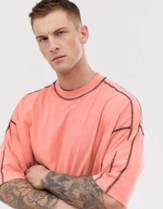 Asos Design DESIGN oversized t-shirt with half sleeve and contrast stitching in acid wash in orange