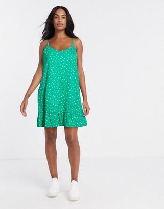 ASOS DESIGN mini strappy dress in green polka dot