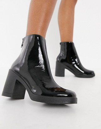Schuh Amara platform heeled ankle boot in black patent
