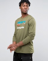 Patagonia Long Sleeve Top With Shop Sticker Print In Regular Fit Green