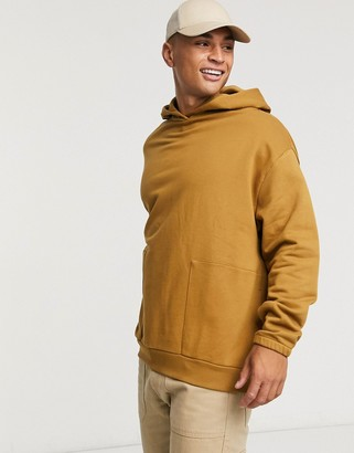 ASOS DESIGN oversized hoodie with square pockets in brown