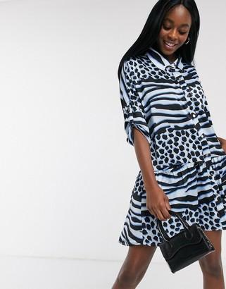 Liquorish mini oversized shirt dress with pleated hem in contrast blue animal print