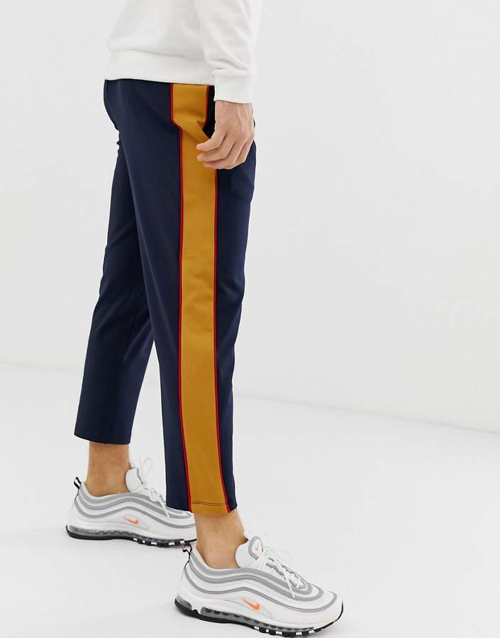 6ae46390 Design DESIGN poly tricot tapered crop sweatpants with side stripe in navy