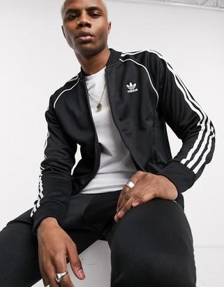adidas Superstar track jacket in black