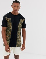 Asos Design DESIGN relaxed t-shirt with leopard print panels and roll sleeve