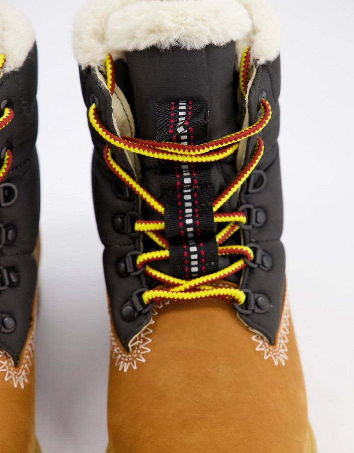 Thumbnail for your product : Timberland 6 inch fur lined boots in wheat and black