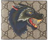 Gucci Wolf print GG Supreme wallet