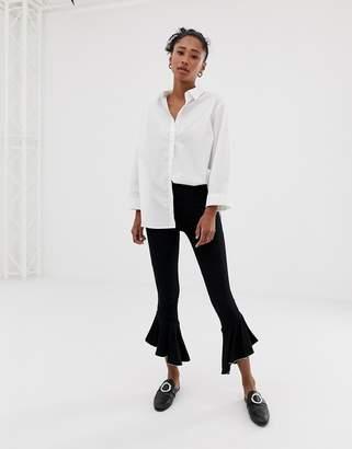 Asos Design DESIGN ruffle hem legging with metal trim-Black