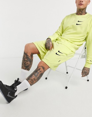 Nike Swoosh logo shorts in neon yellow