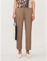 Pleats Please Issey Miyake Cropped wide-leg high-rise plisse trousers