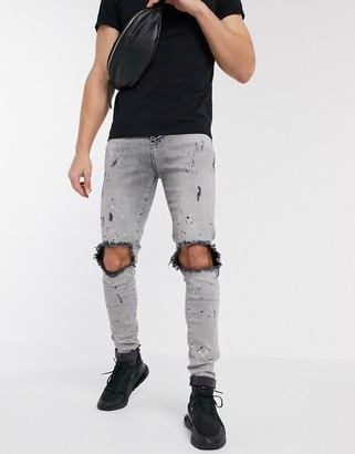 SikSilk skinny jeans with paint splat and knee rips in grey