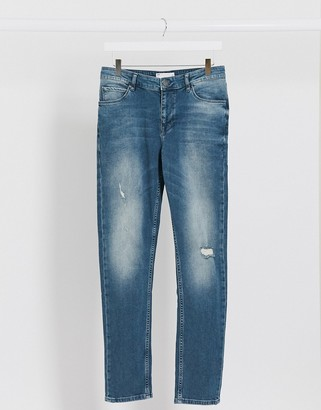 ASOS DESIGN skinny jeans in vintage mid wash tint with abrasions