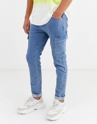 Asos Design DESIGN skinny jeans with cargo pockets in light blue wash