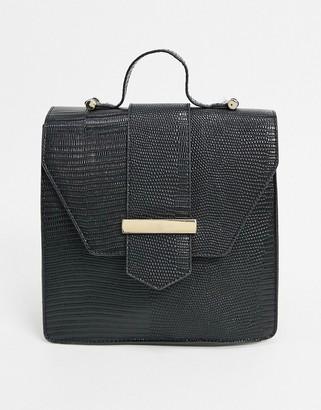 ASOS DESIGN backpack with hardware detail in black lizard