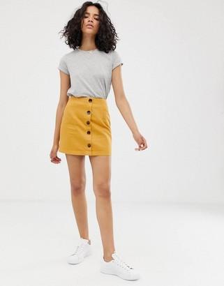 Asos Design DESIGN denim mini skirt with buttons-Cream