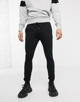 Asos Design DESIGN super skinny joggers in black with silver zip cuffs
