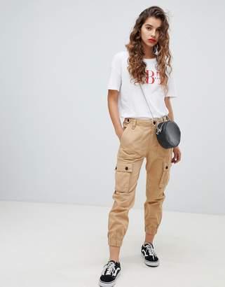 Bershka utility cargo trousers in beige