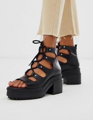 Asos Design DESIGN Sergio lace up mid heels in black
