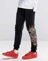 Criminal Damage Joggers With Dragon Print