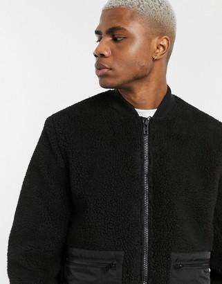 ASOS DESIGN borg bomber jacket in black